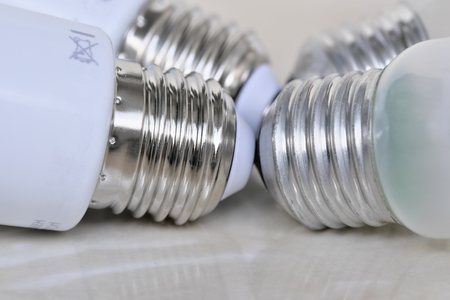 Lighting electric lamps for living rooms LED and incandescent bulbs close-up lie on the table Standard-Bild - 119916449