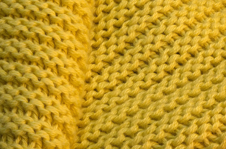 Yellow knitted wool fabric with large loops background Фото со стока