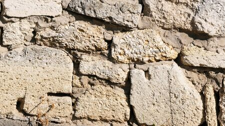 Background from a brick wall macro photo on a summer sunny day Stockfoto