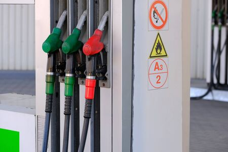 Three pistols of a gas station for filling gasoline and diesel fuel