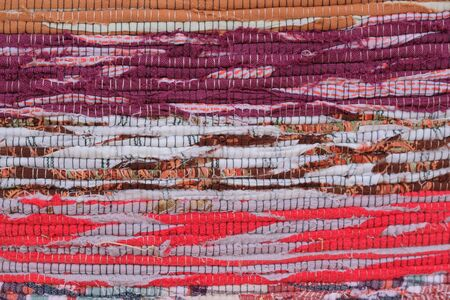 Homespun rug made by hand from colored stripes of fabric