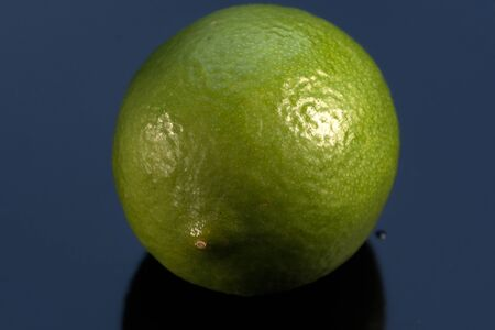 Ripe lime fruit lies on a black background close-up macro photography product background 版權商用圖片