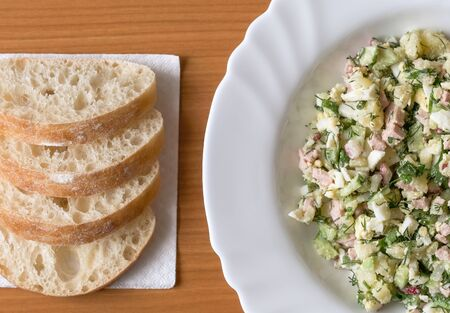 Vegetable salad with sausage, boiled eggs and potatoes, cucumbers, radishes, parsley and dill. It is used with bread kvass and sour cream as a cold first course.