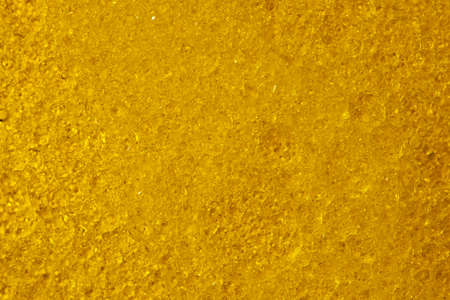Abstract yellow background with water bubbles from oil and fat solvent close up macro photography Banque d'images