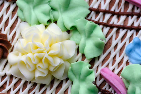 Beautiful flower decoration butter cream sweet cake with nuts close-up macro photography