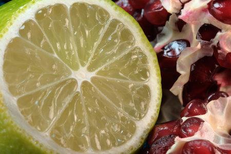 Slice of sweet ripe kiwi close-up macro photography citrus background