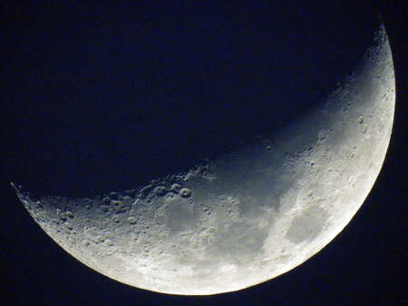 Near half of moon isolated on dark sky