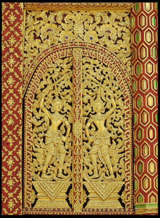 wood door: Traditional wooden craving and painted for windows or doors in Thailand temple.