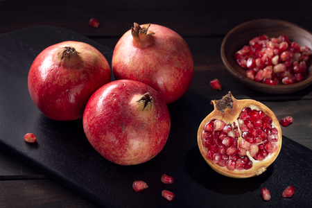 Pomegranates still life in low key. Close up. Punica granatum