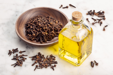 Clove essential oil. Clove oil glass bottle for skin care or acne 版權商用圖片