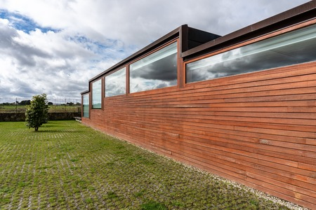 modern building with wood cladding. Cloudy sky Stock fotó