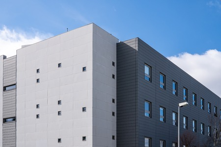 Building facade with metallic cladding. Construction elements of modern architecture Stock fotó
