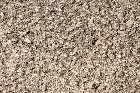 Stone background. Antique Granite stone bush hamered Outdoor wheathered 版權商用圖片