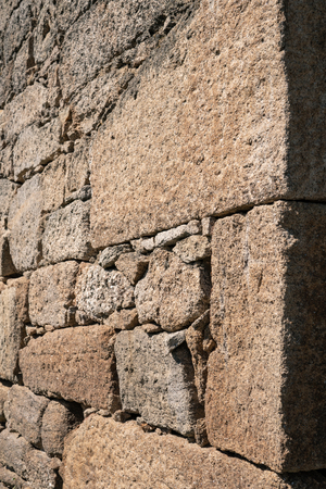 Stone wall background texture. Ancient wall of dry masonry detail