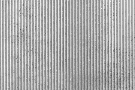 Gray background texture with vertical grooves or flutes