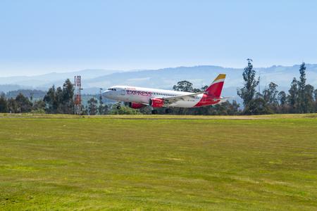 Santiago de Compostela, Spain. April 28 2019: Iberia express Passenger airplane landing on Santiago de Compostela airport Imagens