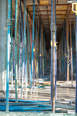 Metallic Struts in building structure under construction. Construction tools Stock Photo