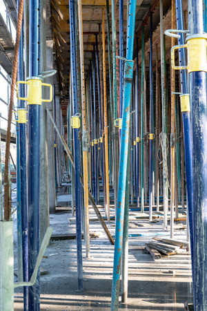 Metallic Struts in building structure under construction. Construction tools