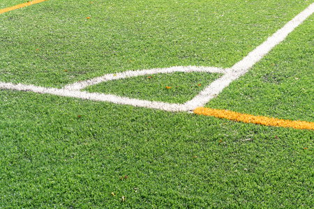 Soccer field with a new artificial turf field, white corner marking. Soccer background with Copy space