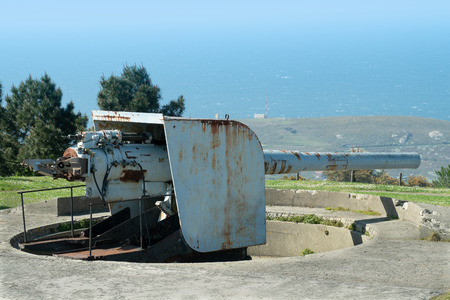 Abandoned Coastal battery cannon with sea at background