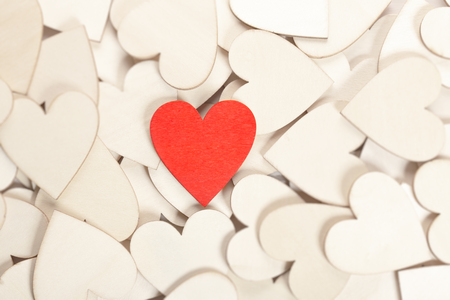 Red wooden heart isolated on wood hearts. Love concept