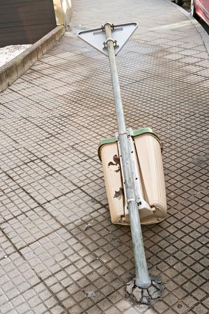 Vandalism or street violence concept. Garbage bin thrown on the sidewalk