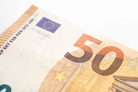 Macro of Fifty euro bill with copy space. 50 number and European Union flag
