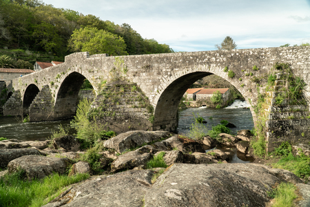 Ancient bridge of Ponte Maceira, Galicia, Spain. Antique stone bridge from 18th century. Camino de Santiago footpath Imagens