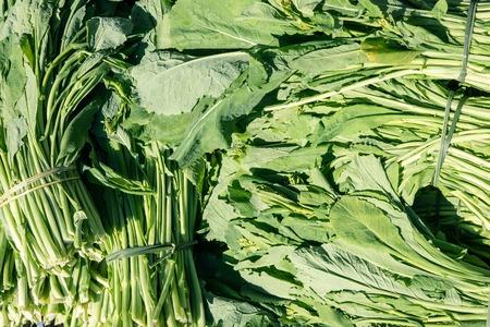 Fresh turnip greens at farmers market. Food Background
