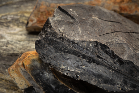 Raw Jet stone isolated on white background.Gemstone used for jewelry