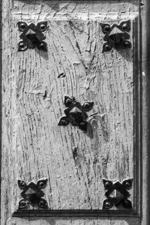 Antique wooden door detail with cracked paint. Grunge background Imagens