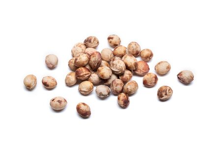 Heap of cherry seeds on white background. Foto de archivo