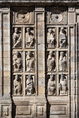 Group of ancient sculptures of Holy Door of santiago de Compostela Cathedral. Statues from 15th century Stock Photo - 130117347