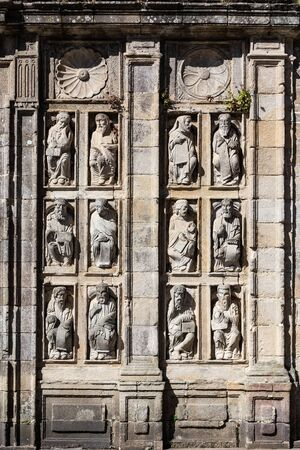 Group of ancient sculptures of Holy Door of santiago de Compostela Cathedral. Statues from 15th century