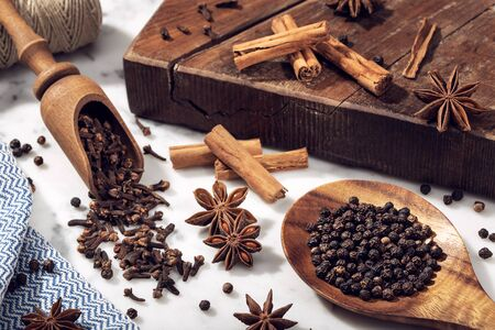 Set of spices on marble table. Star anise, cinnamon, clove and black pepper for cuisine