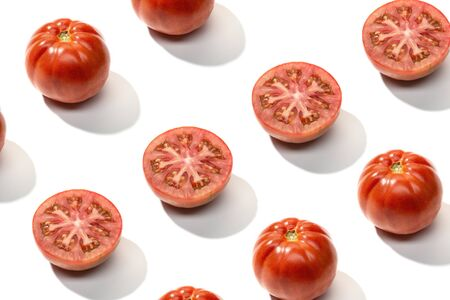 Fresh red tomato pattern isolated on white background