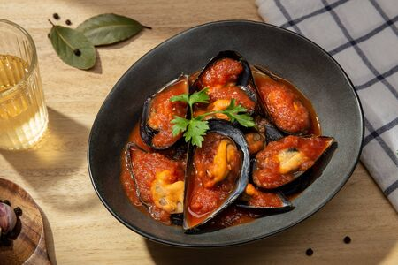 Cooked Mussels. Steamed mussels with hot spiced sauce. Tasty spanish seafood recipe. Top view