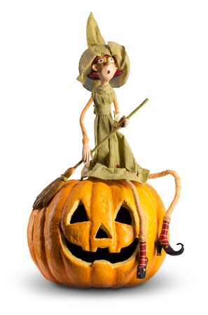 Cute Witch sit on carved Pumpkin. Funny halloween Stok Fotoğraf