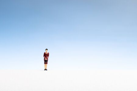 Lonely woman concept. Woman miniature on abstract space. Copy space