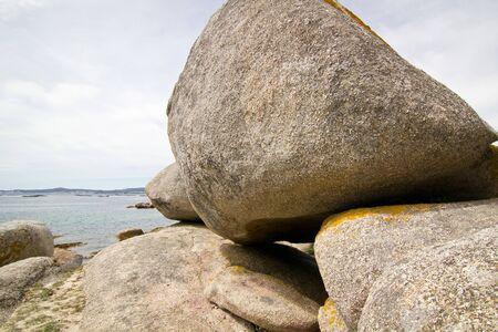Scenic formation of big round rocks on atlantic shore. Arousa island, Pontevedra, Spain