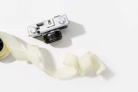 Background of vintage photo camera. Rangefinder film camera. Gray background. Copy space