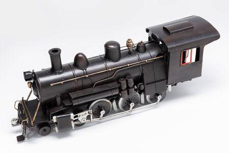 Old train machine tin toy isolated on white Standard-Bild