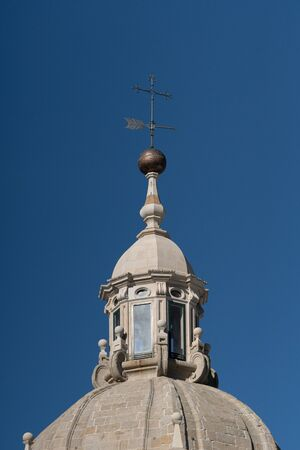 weather vane or wind vane and dome lantern on the top of a tower of santiago de Compostela Cathedral