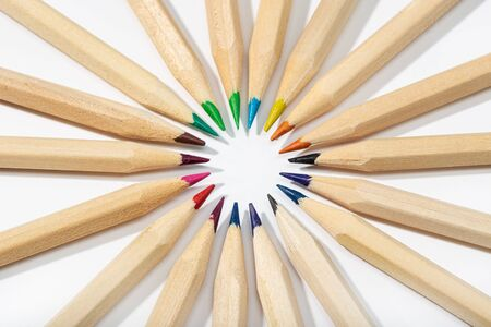 Colored pencils arranged in a circle. Back to school background. Top view