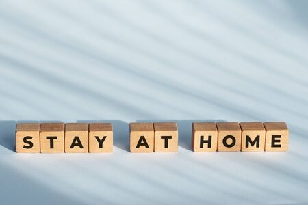 Stay at home phrase on wooden dices. Coronavirus outbreak advice. Copy space