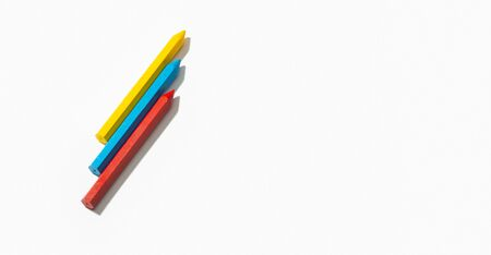 Colored crayons isolated on white background. Copy space for text. Back to school concept