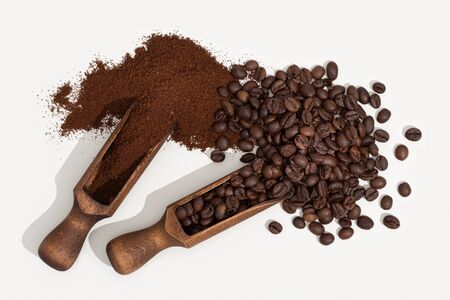 Roasted coffee beans and coffee ground isolated on white background. Top view