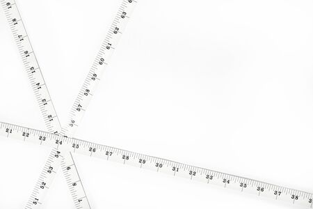 White Measure tape isolated on white background. Weight loss, diet, overweight concept. Copy space