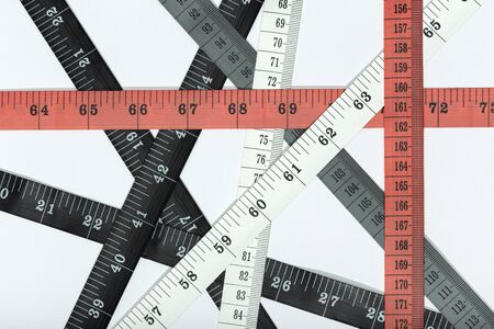 Group of Measure tape isolated on white background. Weight loss, diet, overweight concept. Copy space Stock Photo