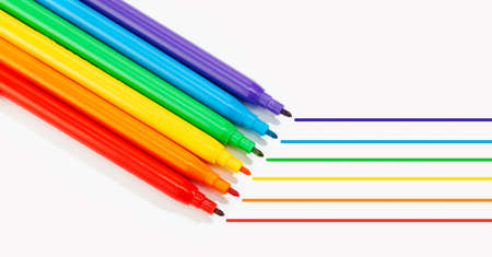 Markers of rainbow colors isolated on white background. LGBTQ rainbow flag Gay pride background. Copy space